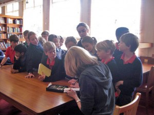 Children wait eagerly to get their books signed after one of author Marita Phillips' school talks